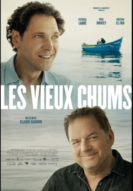 Les vieux chums - le visage souriant des deux comédiens principaus sur l'affiche, avec en arrière plan une barque sur une mer calme.